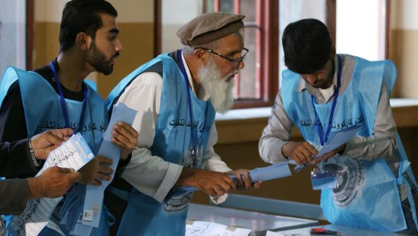 Afghan election commission workers count ballot papers of the presidential election in Kabul, Afghanistan September 28, 2019 - Sputnik International
