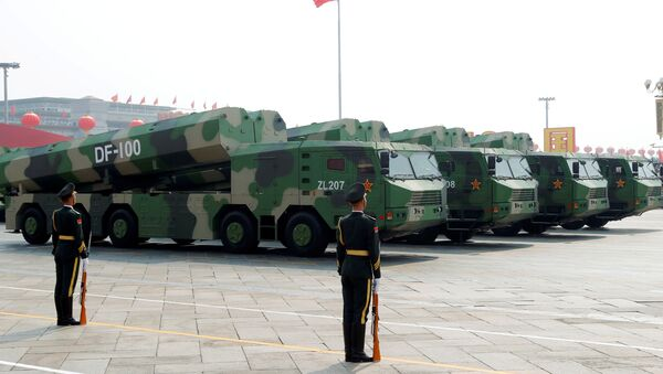 Military vehicles carrying hypersonic cruise missiles DF-100 drive past Tiananmen Square during the military parade marking the 70th founding anniversary of People's Republic of China, on its National Day in Beijing, China October 1, 2019 - Sputnik International
