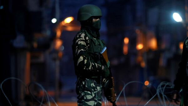 An Indian security force personnel stands guard in a street early morning during restrictions following scrapping of the special constitutional status for Kashmir by the Indian government, in Srinagar, September 27, 2019 - Sputnik International