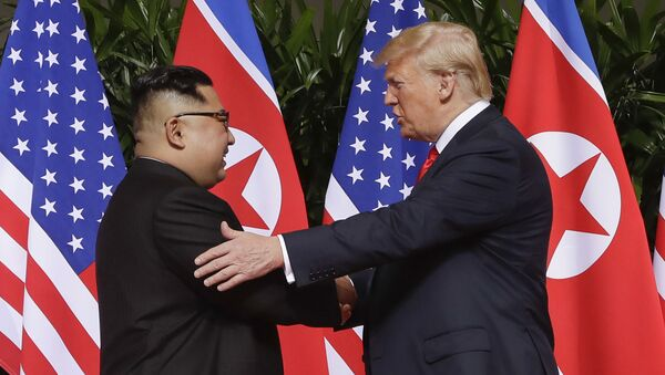 n this June 12, 2018 file photo, U.S. President Donald Trump, right, shakes hands with North Korea leader Kim Jong Un at the Capella resort on Sentosa Island in Singapore. Kim's fifth meeting with Chinese President Xi Jinping continues his ambitious diplomatic outreach that has included summits with the leaders of the United States, South Korea and Russia in the past year and a half. Experts say Kim is attempting to form a united front with North Korea's main ally China to strengthen his leverage in the stalled nuclear negotiations with the United States.  - Sputnik International