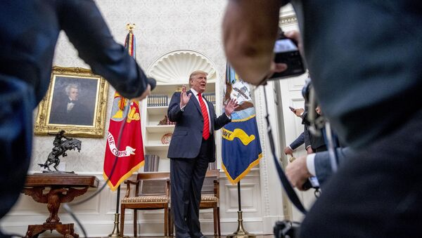 President Donald Trump speaks to member of the media as he departs a ceremonial swearing in ceremony for new Labor Secretary Eugene Scalia in the Oval Office of the White House in Washington, Monday, Sept. 30, 2019 - Sputnik International