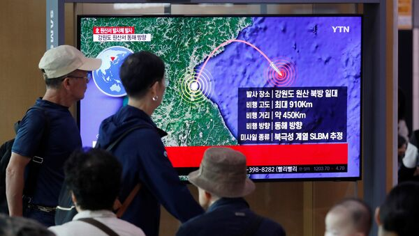 People watch a TV broadcasting a news report on North Korea firing a missile that is believed to be launched from a submarine, in Seoul, South Korea, October 2, 2019 - Sputnik International