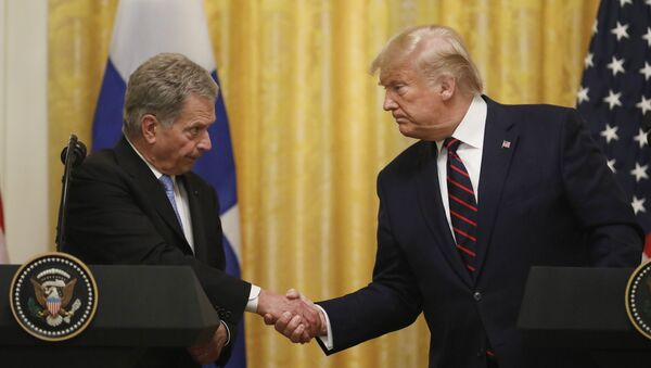 President Donald Trump shakes hands with Finnish President Sauli Niinisto, as they participate in a news conference at the White House in Washington, Wednesday, Oct. 2, 2019 - Sputnik International