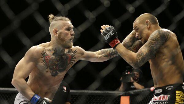 Conor McGregor, left, and Dustin Poirier, during their fight, Saturday, Sept. 27, 2014, in Las Vegas - Sputnik International