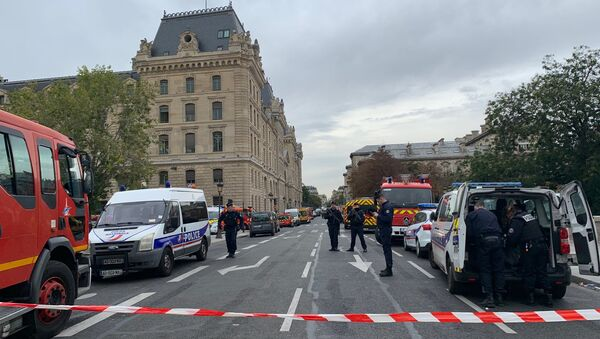 French police secure the area in front of the Paris Police headquarters in Paris, France, October 3, 2019 - Sputnik International