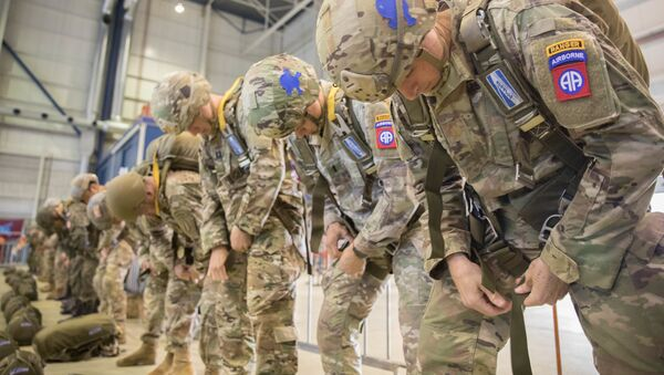 A group of U.S. Army and International Paratroopers rig into their parachutes and prepare to jump into Groesbeck Drop Zone during the 75th Anniversary of Market Garden on Einhoven Air Field, Einhoven, Netherlands., September 19, 2019 - Sputnik International