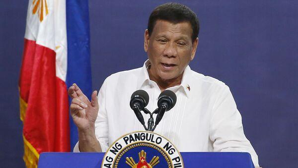FILE - In this Aug. 27, 2019, file photo, Philippine President Rodrigo Duterte gestures as he addresses the topic of land reform in Manila, Philippines - Sputnik International