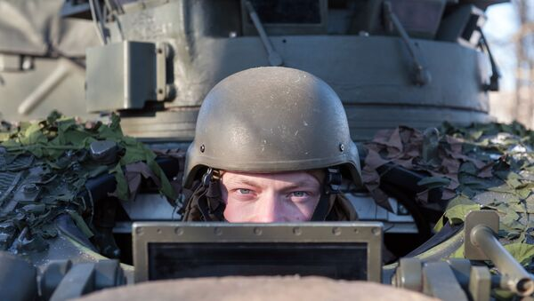 A soldier looking out of the British armed reconnaissance vehicle FV107 SCIMITAR during a NATO demonstration of military vehicles and weapons in Latvia. - Sputnik International
