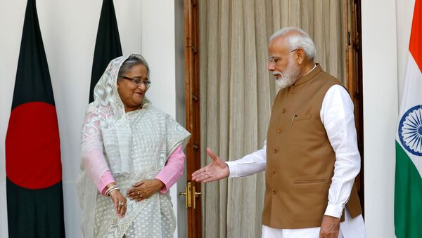 India's Prime Minister Narendra Modi shakes hands with his Bangladeshi counterpart Sheikh Hasina before their meeting at Hyderabad House in New Delhi, India, October 5, 2019.  - Sputnik International