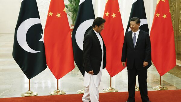 China's President Xi Jinping meets Pakistan's Prime Minister Imran Khan at the Great Hall of the People in Beijing, Friday, Nov. 2, 2018 - Sputnik International