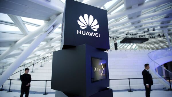 In this May 26, 2016 photo, security personnel stand near a pillar with the Huawei logo at a launch event for the Huawei MateBook in Beijing. Huawei Technology Ltd., the Chinese smartphone and telecom equipment maker, said Friday, March 30, 2018, that its 2017 profit rose 28.1 percent, boosted by strong sales for its enterprise and consumer units - Sputnik International