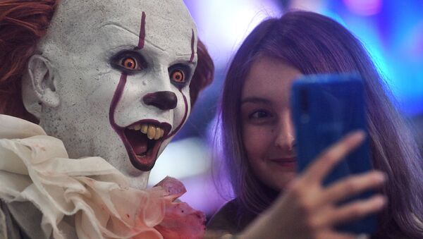 A visitor and a cosplayer at the IgroMir 2019 exhibition and the Comic Con Russia 2019 festival at the International Crocus Expo Exhibition Centre in Moscow.   - Sputnik International