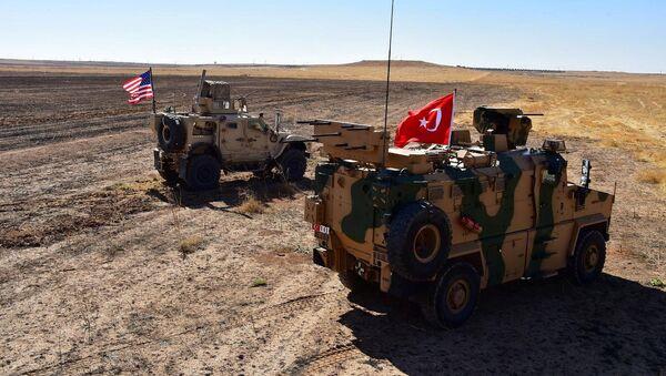 Turkish and U.S. military vehicles are seen on the Syrian-Turkish border during a joint U.S.-Turkey patrol near Tel Abyad, Syria, September 8, 2019 - Sputnik International