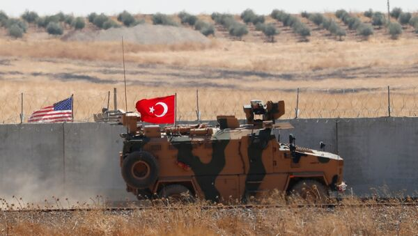 A Turkish military vehicle returns after a joint U.S.-Turkey patrol in northern Syria, as it is pictured from near the Turkish town of Akcakale, Turkey, September 8, 2019 - Sputnik International