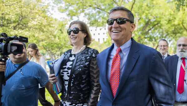 Michael Flynn, President Donald Trump's former national security adviser, leaves the federal court with his lawyer Sidney Powell, left, following a status conference with Judge Emmet Sullivan, in Washington, Tuesday, Sept. 10, 2019 - Sputnik International