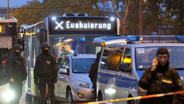A bus reading evacuation is escorted by the police past the site of a shooting in Halle an der Saale, eastern Germany, on October 9, 2019. - Sputnik International