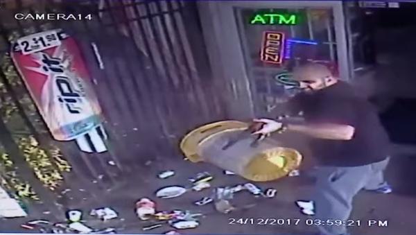 Saf Ahmad, the owner of a Lauderhill-area Kwick Pick, is seen firing an AK-47 at a customer - Sputnik International