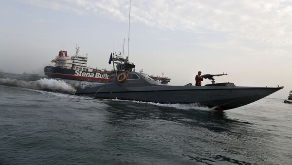 In this July 21, 2019 file photo, a speedboat of the Iran's Revolutionary Guard moves around a British-flagged oil tanker, the Stena Impero, which was seized by the Guard, in the Iranian port of Bandar Abbas.  - Sputnik International