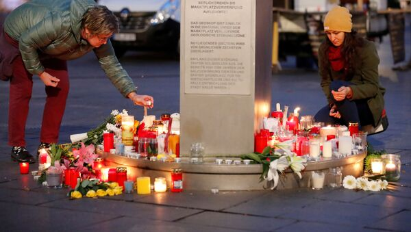 People place candles at central market square in Halle, Germany October 10, 2019, after two people were killed in a shooting - Sputnik International