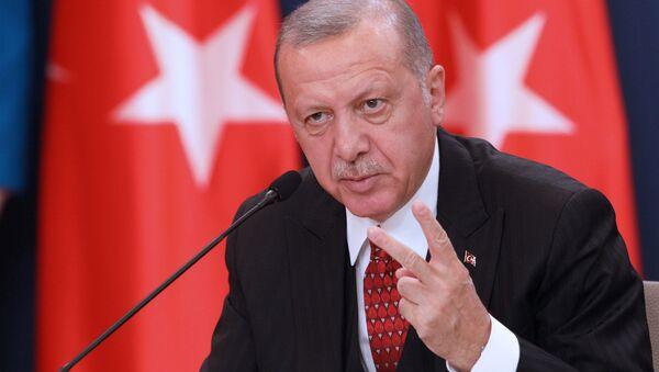 Turkish President Tayyip Erdogan attends a joint press conference with Serbia's President Aleksandar Vucic after their meeting in Belgrade, Serbia, October 7, 2019 - Sputnik International