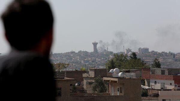 Tires are seen being burned in Syria's Qamishli  - Sputnik International