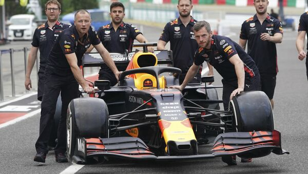 The car of Red Bull driver Max Verstappen of the Netherlands is pushed toward his garage at the Suzuka Circuit in Suzuka, central Japan - Sputnik International