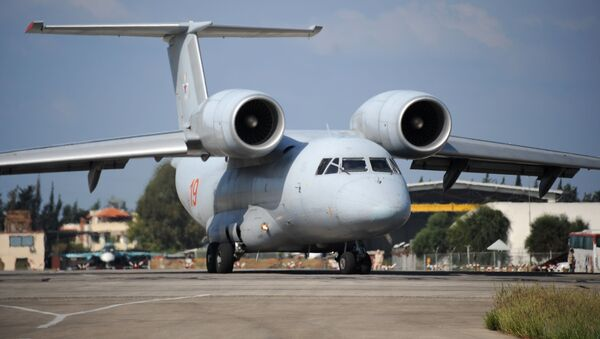 A Russian An-72 transport plane prepares to take off at the Russian military base of Hmeimim, located south-east of the city of Latakia in Hmeimim, Latakia Governorate, Syria, on September 26, 2019 - Sputnik International