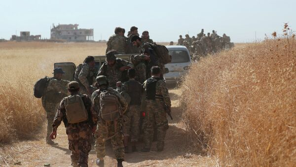 Turkey-backed Syrian rebel fighters are seen together in the village of Yabisa, near the Turkish-Syrian border, Syria, October 12, 2019.  - Sputnik International