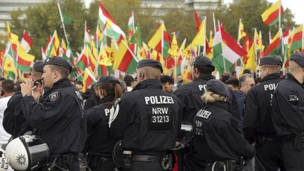 Police secures a protest against the Turkish invasion in Kurdish territories in northern Syria in Cologne, Germany - Sputnik International