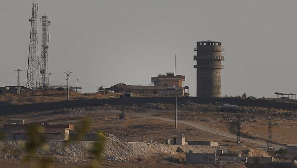 In this photo taken from the Turkish side of the border between Turkey and Syria, in Suruc, southeastern Turkey, a U.S forces outpost is seen on a hilltop outside Ayn Al Arab or Kobani, Syria, Saturday, Oct. 12, 2019.  - Sputnik International
