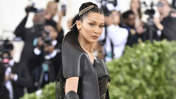 Bella Hadid attends The Metropolitan Museum of Art's Costume Institute benefit gala celebrating the opening of the Heavenly Bodies: Fashion and the Catholic Imagination exhibition on Monday, May 7, 2018, in New York.  - Sputnik International