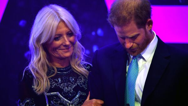 Britain's Prince Harry reacts next to television presenter Gaby Roslin as he delivers a speech during the WellChild Awards Ceremony reception in London, Britain, October 15, 2019 - Sputnik International