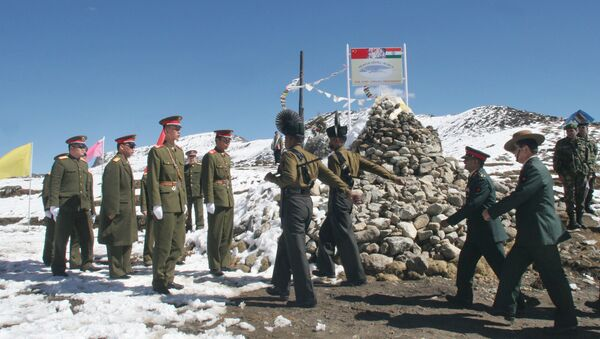 A delegation of the Indian Army, right, marches to meet the delegation of the Chinese army, left, at a Border Personnel Meeting (BPM) on the Chinese side of the Line of Actual Control at Bumla, Indo-China Border, Monday, Oct. 30, 2006 - Sputnik International