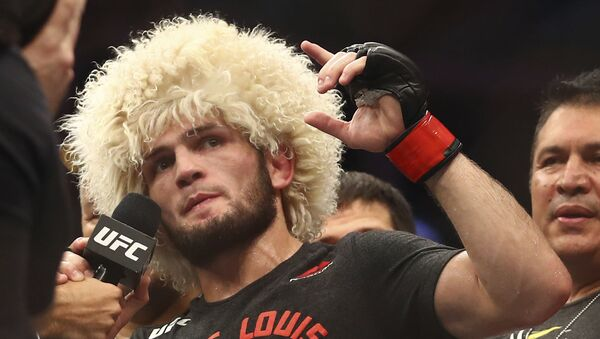 Russian UFC fighter Khabib Nurmagomedov speaks after wining against UFC fighter Dustin Poirier, of Lafayette, La., during Lightweight title mixed martial arts bout at UFC 242, in Yas Mall in Abu Dhabi, United Arab Emirates, Saturday , Sept.7 2019 - Sputnik International
