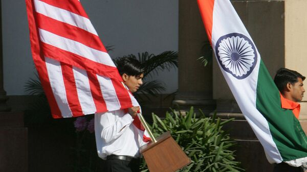 Indian workers carry the U.S. flag, left, and the Indian flag at Hyderabad House, the venue of the talks between U.S. President George W. Bush and Indian Prime Minister Manmohan Singh in New Delhi, India, Thursday, March 2, 2006 - Sputnik International