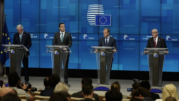 EU chief Brexit negotiator Michel Barnier, Ireland's Prime Minister Leo Varadkar, European Council President Donald Tusk and European Commission President Jean-Claude Juncker address a press conference during an European Union Summit at European Union Headquarters in Brussels on October 17, 2019. - Sputnik International