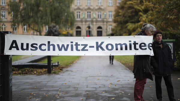 Two women of the Auschwitz Committee show a poster near the criminal court in Hamburg, Thursday, Oct. 17, 2019. 93-year-old former SS private Bruno Dey is going on trial at the court on 5,230 counts of being an accessory to murder, accused of helping the Nazis' Stutthof concentration camp function.  - Sputnik International