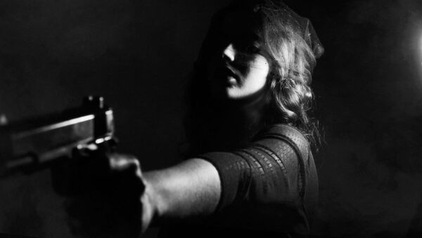 Woman with a gun - Sputnik International