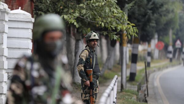 Indian Border Security Force soldiers guard outside the residence of former Chief Minister of Jammu and Kashmir and National Conference party president Farooq Abdullah before Abdullah met his party colleagues in Srinagar, Indian controlled Kashmir, Sunday, Oct. 6, 2019.  - Sputnik International