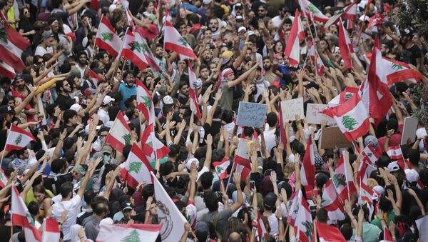 Anti-government protesters shout slogans in Beirut, Lebanon, Sunday, Oct. 20, 2019. Thousands of people are gathering in downtown Beirut as Lebanon is expected to witness the largest protests on the fourth day of anti-government demonstrations. - Sputnik International