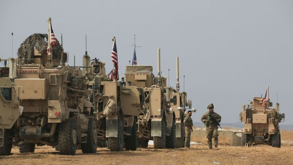 American military convoy stops near the town of Tel Tamr, north Syria, Sunday, Oct. 20, 2019.  - Sputnik International
