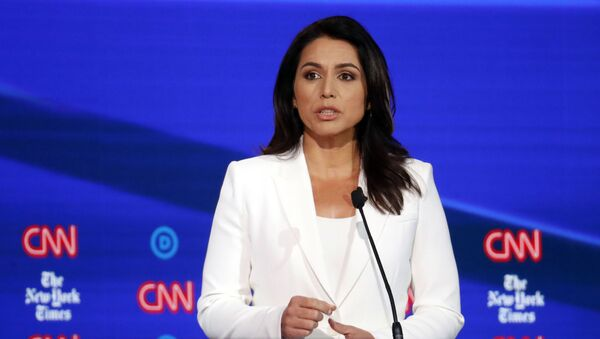 Democratic presidential candidate Rep. Tulsi Gabbard, D-Hawaii, speaks during a Democratic presidential primary debate hosted by CNN/New York Times at Otterbein University, Tuesday, Oct. 15, 2019, in Westerville, Ohio - Sputnik International