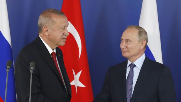 Turkish President Recep Tayyip Erdogan, left, shakes hands with Russian President Vladimir Putin during a joint news conference following their talks on the sidelines of the MAKS-2019 International Aviation and Space Show in Zhukovsky, outside Moscow, Russia, on 27 August 2019.  - Sputnik International