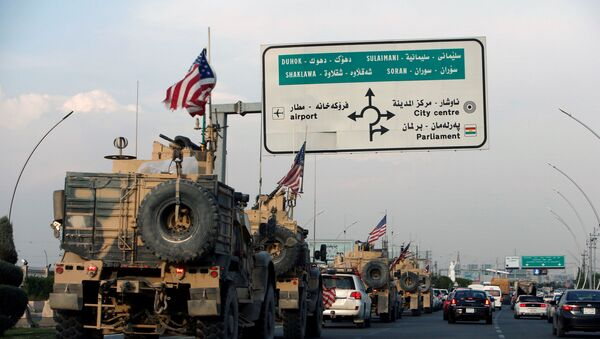 A convoy of U.S. vehicles is seen after withdrawing from northern Syria, in Erbil, Iraq October 21, 2019 - Sputnik International