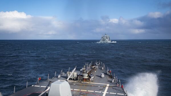 The Arleigh Burke-class guided-missile destroyer USS Donald Cook (DDG 75) approaches the Royal Fleet Auxiliary Tide-class replenishment tanker Tidesurge (A138) for a refueling at sea, Oct. 18, 2019.  - Sputnik International