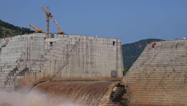 Water flows through Ethiopia's Grand Renaissance Dam as it undergoes construction work on the river Nile in Guba Woreda, Benishangul Gumuz Region, Ethiopia September 26, 2019 - Sputnik International