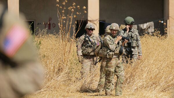 Turkish and American soldiers stand near a former YPG military point during a joint U.S.-Turkey patrol, near Tel Abyad, Syria September 8, 2019 - Sputnik International
