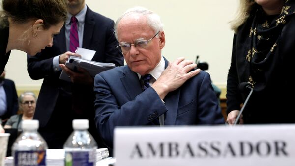James Jeffrey, U.S. State Department special representative for Syria Engagement, listens to his aide before a House Foreign Affairs Committee hearing on President Trump's decision to remove U.S. forces from Syria, on Capitol Hill in Washington, U.S., October 23, 2019 - Sputnik International