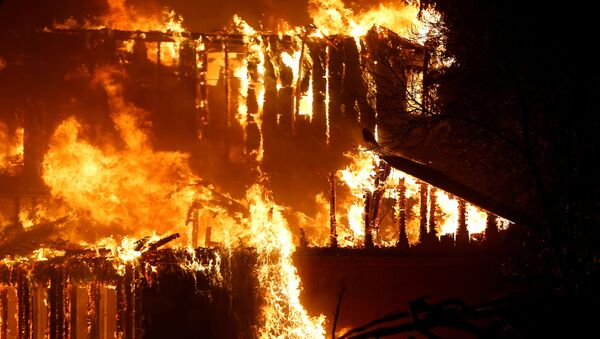 A structure burns during the Kincade fire in Geyserville, California - Sputnik International