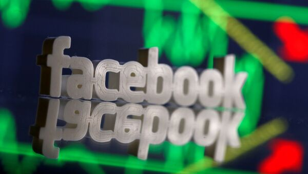A 3D-printed Facebook logo is seen in front of displayed stock graph in this illustration photo, March 20, 2018 - Sputnik International